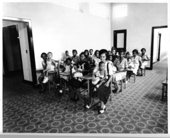 Patients wait for the doctor at the Slossfield health clinic. Photo by UAB Archives