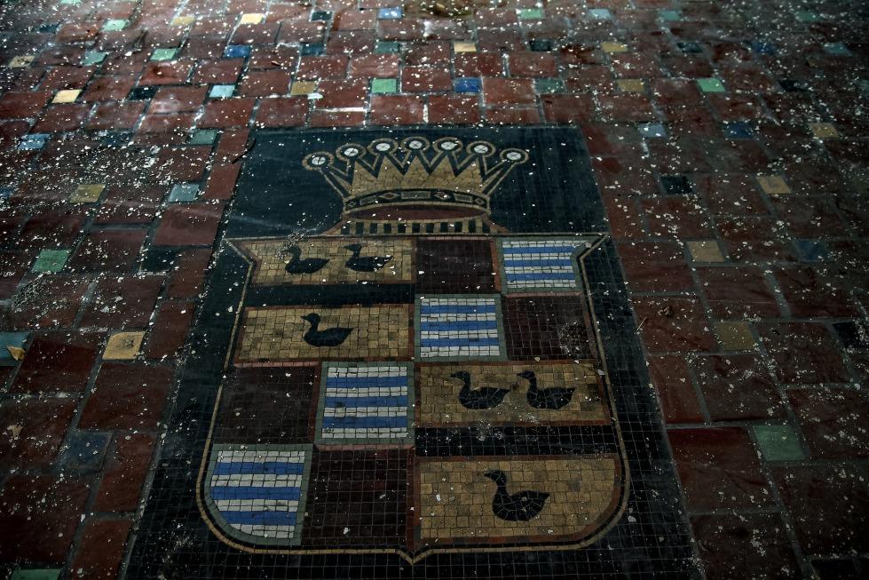 A mosaic tile Cadillac symbol at the front entrance