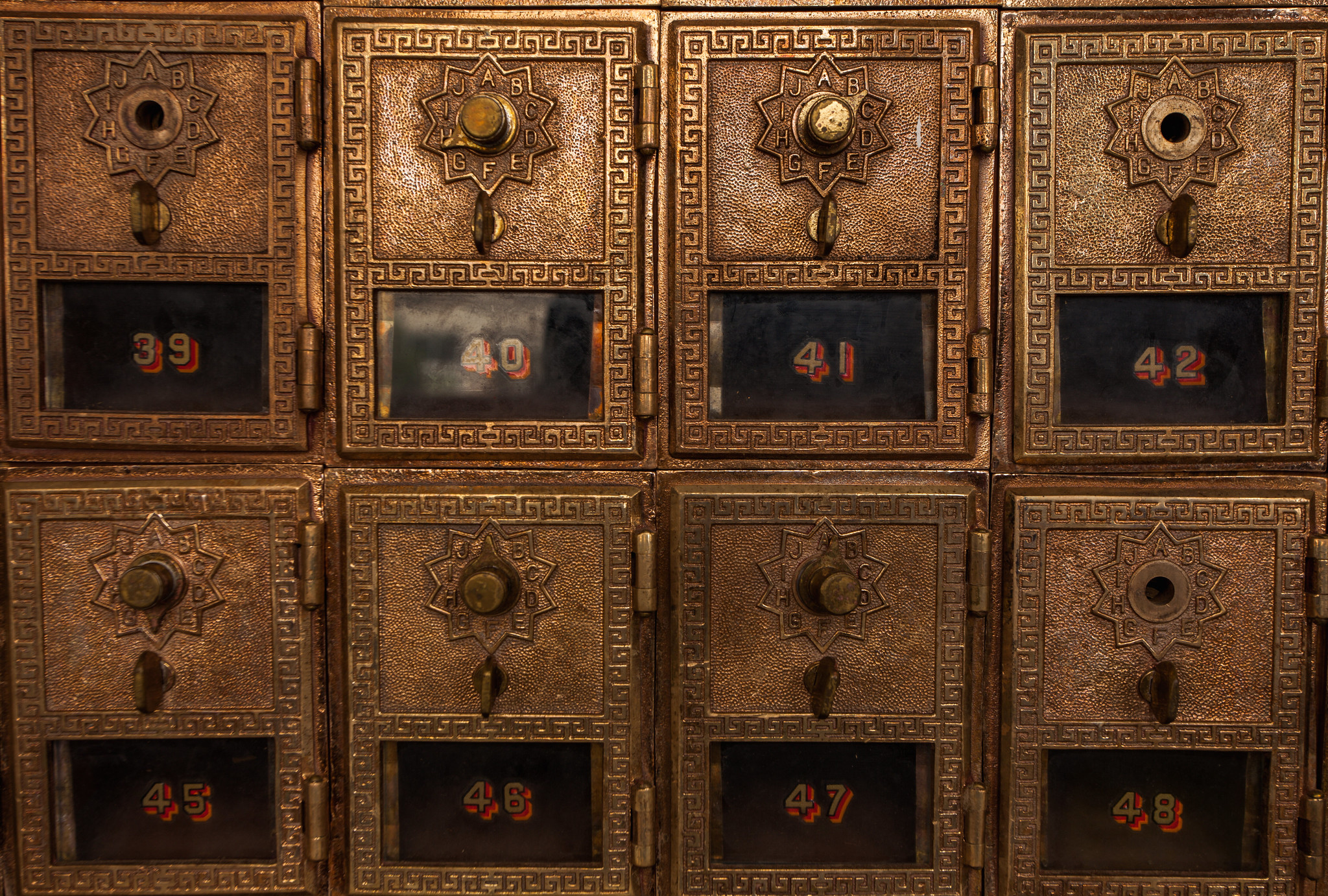 The original post office boxes remain inside of the building.